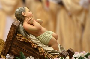 The unveiled baby Jesus during a Christmas Eve mass at St Peter's Basilica lead by Pope Francis to mark the nativity of Jesus Christ, on December 24, 2014 at the Vatican. (Credit: ALBERTO PIZZOLI/AFP/Getty Images)