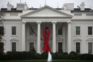 A red ribbon is displayed on the North Portico of the White House to recognize World AIDS Day, December 1, 2015 in Washington, DC. (Credit: Mark Wilson/Getty Images)