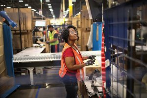 Workers pack and ship customer orders at the 750,000-square-foot Amazon fulfillment center in Romeoville, Illinois, on Aug. 1, 2017. (Credit: Scott Olson / Getty Images)