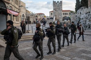 Members of the Israeli Border Police patrol through the Old City on Dec. 7, 2017, in Jerusalem. (Credit: Chris McGrath / Getty Images)