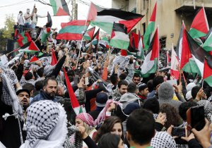 Protestors wave the Palestinian flag during a demonstration outside the U.S. embassy in Awkar, on the outskirts of the Lebanese capital Beirut, on Dec. 10, 2017. (Credit: Anwar Amro / AFP / Getty Images)