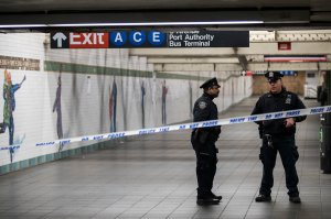 Police stand in a closed-off underground walkway near the site of a pipe bomb explosion in the tunnel that connects the Times Square subway station to the Port Authority Bus Terminal, Dec. 11, 2017, in New York City. (Credit: Drew Angerer/Getty Images)