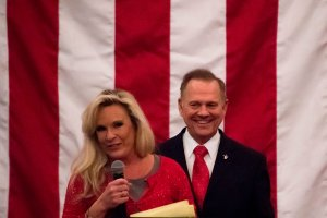 Republican Senatorial candidate Roy Moore smiles as his wife Kayla speaks at a rally in Midland, Alabama, on December 11, 2017. (Credit: JIM WATSON/AFP/Getty Images)