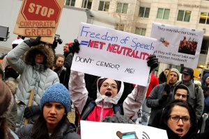 Demonstrators rally outside the Federal Communication Commission building to protest against the end of net neutrality rules on December 14, 2017 in Washington, DC. (Credit: Chip Somodevilla/Getty Images)