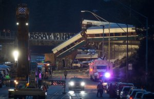 Work crews prepare to clear southbound I-5 lanes at the scene of an Amtrak train derailment on December 18, 2017 in DuPont, Washington. At least six people were killed when several train cars plunged from the bridge. (Credit: Stephen Brashear/Getty Images)