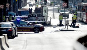 Police and emergency personnel work at the scene of where a car ran over pedestrians in Flinders Street in Melbourne on Dec. 21, 2017. (Credit: Mal Fairclough/AFP/Getty Images)