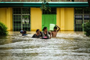 Residents evacuate to a safer place in Kabacan, North Cotabato, on the southern island of Mindanao on Dec. 23, 2017, after Tropical Storm Tembin dumped torrential rains across the island. (Credit: Ferdinandh Cabrera/AFP/Getty Images)