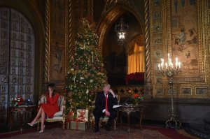 President Donald Trump and First Lady Melania Trump participate in NORAD Santa Tracker phone calls at the Mar-a-Lago resort in Palm Beach, Florida, on Dec. 24, 2017. (Credit: Nicholas Kamm / AFP / Getty Images)
