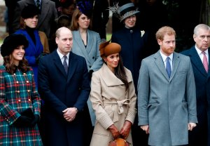 Britain's Catherine, Duchess of Cambridge, and Britain's Prince William, Duke of Cambridge, actress and fiancee of Britain's Prince Harry Meghan Markle, and Britain's Prince Harry, stand together as they wait to see off Britain's Queen Elizabeth II after attending the Royal Family's traditional Christmas Day church service at St Mary Magdalene Church in Sandringham, Norfolk, eastern England, on December 25, 2017.(Credit: ADRIAN DENNIS/AFP/Getty Images)