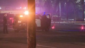 Police investigate a deadly hit-and-run crash in South Los Angeles on Dec. 25, 2017. (Credit: KTLA)