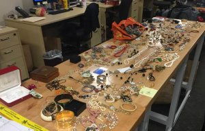 Investigators were looking to find the owners of the jewelry and other items seen in this photo provided by the Orange County Sheriff's Department on Dec. 21, 2017.