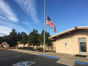 A half-staff flag is seen at Cal Fire's El Cajon station after a firefighter died in the Thomas Fire on Dec. 14, 2017. (Credit: Cal Fire)