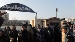 People demonstrate outside the offices of the Al-Qaeda-linked Islamic State of Iraq and the Levant, demanding that they stop fighting with the rebels, on Jan. 6, 2014, in the northern Syrian city of Aleppo. (Credit: MOHAMMED WESAM/AFP/Getty Images)