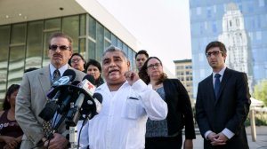 Aureliano Santiago, a street vendor, answers questions from reporters during a 2015 news conference about a lawsuit filed against the city of Los Angeles. Santiago was a plaintiff in the case. (Credit: Marcus Yam / Los Angeles Times)