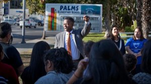 Olu K. Orange, an attorney representing teachers and students, announces a lawsuit attempting to prevent a construction project adjacent to Palms Elementary School, naming concerns such as toxic dust and noise that would distract hearing-impaired students, on Dec. 15, 2017. (Credit: Allen J. Schaben / Los Angeles Times)