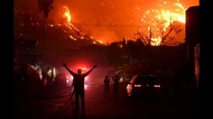 esidents watch the Thomas fire burn in the hills above La Conchita in Ventura County. (Credit: Wally Skalij / Los Angeles Times)