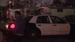 The L.A. County Sheriff's Department investigates a shooting that left a woman dead and the suspect injured on Dec. 25, 2017. (Credit: KTLA)