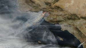A satellite photo from NASA shows multiple columns of gray-brown smoke coming from the Thomas Fire that is raging in Ventura County on Dec. 7, 2017.