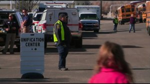 Students gather in the parking lot at Aztec High School in Aztec, New Mexico, after a deadly shooting occurred there on Dec. 7, 2017. (Credit: KOAT via CNN)