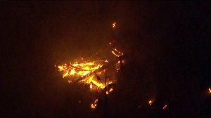 The Skirball Fire flares in Bel-Air on Dec. 6, 2017. (Credit: KTLA)