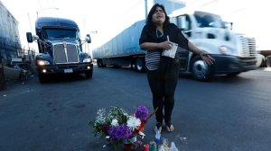 Aileen Kemper shows where a hit-and-run driver struck and killed her mother outside the RV in which they lived in Boyle Heights. Large trucks pass by all day. (Credit: Mel Melcon / Los Angeles Times)