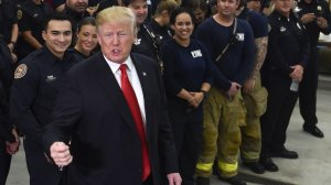 President Donald Trump speaks to first responders at West Palm Beach Fire & Rescue in West Palm Beach, Fla. on Dec. 27, 2017. During his visit, he made the false claim that the first term of his presidency saw more laws signed than any other. (Credit: Nicholas Kamm/AFP/Getty Images)