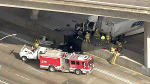 A big rig is seen after it fell onto the 5 Freeway in Pacoima from an overpass on Jan. 9, 2018. (Credit: KTLA)