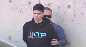 A person is taken into custody in connection with the Blaze Bernstein homicide investigation on Jan. 12, 2018. (Credit: KTLA)