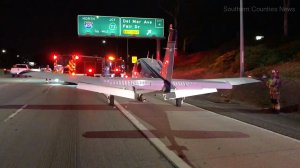 A small plane landed on the 55 Freeway in Costa Mesa on Jan. 28, 2018. (Credit: Southern Counties News)