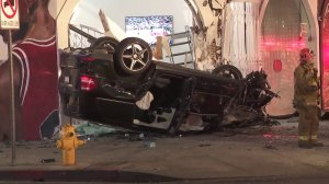 An overturned SUV is seen after a crash on Jan. 1, 2018, in the Fairfax district. (Credit: KTLA)