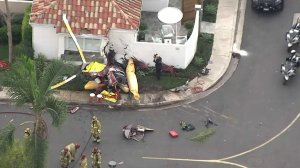 The helicopter hit a home when it crashed in Newport Beach on Jan. 30, 2018. (Credit: KTLA)
