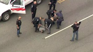A man and a woman are taken into custody in Montebello after leading police on a lengthy pursuit in the Southeast L.A. area on Jan. 3, 2018. (Credit: KTLA)