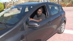 Desionne Franklin sits in his Prius Jan. 11, 2018, two days after riding it down a river of mud in Burbank. (Credit: KTLA)