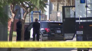 Officers hold down the scene of a police shooting in Montecito Heights on Jan. 14, 2018. (Credit: KTLA)