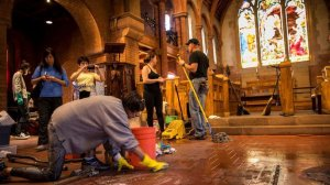 Community volunteers help clean damage caused by an arson fire started inside the Church of the Angels in Pasadena on Jan. 13, 2018. (Jay L. Clendenin / Los Angeles Times)
