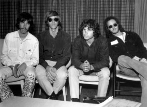 American psychedelic rock band, The Doors during a press conference at Heathrow Airport, London (left to right); drummer John Densmore, keyboard player Ray Mansarek, vocalist Jim Morrison (1943 - 1971) and guitarist Robby Krieger. (Credit: Central Press/Getty Images)