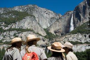 Park rangers meet in front of Yosemite Falls before President Barack Obama's speech in Yosemite National Park on June 18, 2016. (Credit: David Calvert / Getty Images)