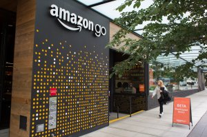 A woman walks past the Amazon Go grocery store at the Amazon corporate headquarters on June 16, 2017 in Seattle, Washington. (Credit: David Ryder/Getty Images)