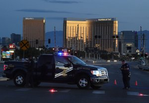 Police form a perimeter around the road leading to the Mandalay Hotel after a gunman opened fire on a country music concert in Las Vegas, Nevada on Oct. 2, 2017. (Credit: MARK RALSTON/AFP/Getty Images)