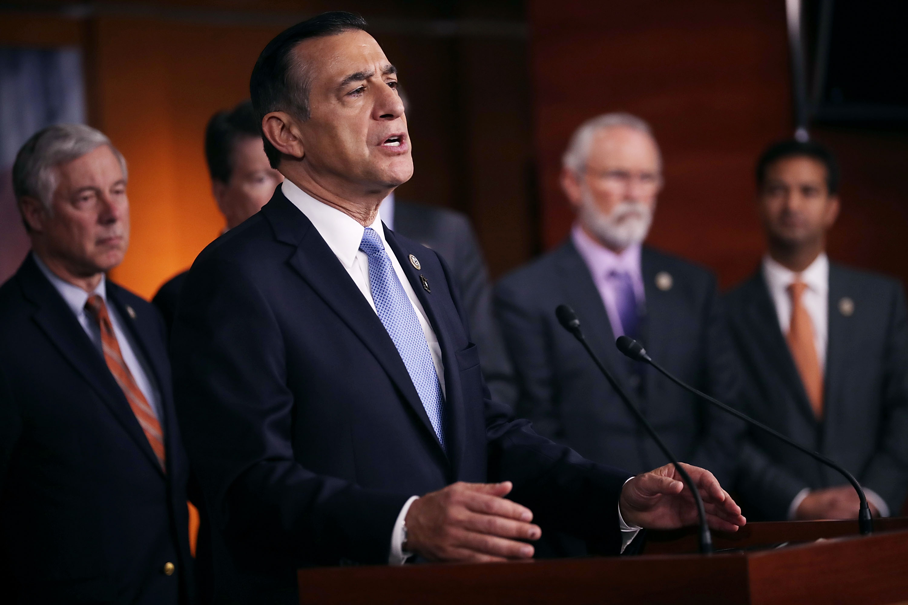Rep. Darryll Issa is joined by more than a dozen Republican members of Congress as he speaks during a news conference about the Deferred Action for Childhood Arrivals (DACA) program at the U.S. Capitol on Nov. 9, 2017. (Credit: Chip Somodevilla / Getty Images)