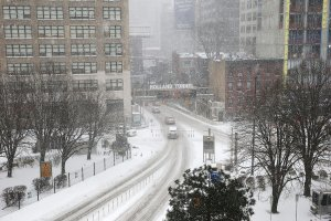 """The Holland Tunnel entrance sign advises """"Avoid Unnecessary Travel"""" during major snow storm on Jan. 4, 2018 in New York City. (Credit: Daniel Pierce Wright/Getty Images)"""