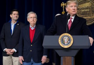 Donald Trump speaks alongside Speaker of the House Paul Ryan, left, and Senate Majority Leader Mitch McConnell, center, during a retreat with Republican lawmakers and members of his Cabinet at Camp David in Thurmont, Maryland on Jan. 6, 2018. (Credit: SAUL LOEB/AFP/Getty Images)