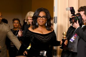 Oprah Winfrey arrives with the Cecil B. DeMille Award in the press room during The 75th Annual Golden Globe Awards at The Beverly Hilton Hotel on January 7, 2018 in Beverly Hills. (Credit: Kevin Winter/Getty Images)