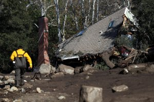 A home that was destroyed by a mudslide sits on its side in a field of debris on January 11, 2018 in Montecito, California. (Credit: Justin Sullivan/Getty Images)
