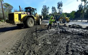 Cleanup operations continue on a section of the 101 Freeway in Santa Barbara County closed by mudflow in Montecito, on Jan. 12, 2018. (Credit: FREDERIC J. BROWN/AFP/Getty Images)