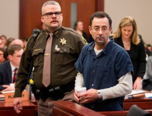 Dr. Larry Nassar is led to the witness box during his sentencing hearing in Lansing, Michigan, Jan. 16, 2018. (Credit: GEOFF ROBINS/AFP/Getty Images)