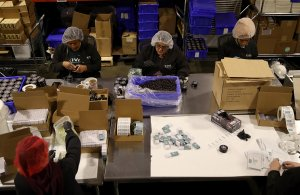 Workers package marijuana infused chocolate edibles at Kiva Confections in Oakland on Jan. 16, 2018. (Credit: Justin Sullivan / Getty Images)