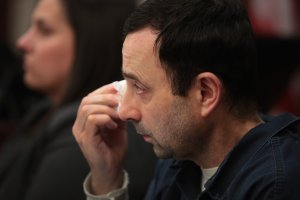 Larry Nassar wipes a tear as he listens to Carrie Hogan deliver a victim impact statement at his sentencing hearing on Jan. 17, 2018, in Lansing, Michigan. (Credit: Scott Olson / Getty Images)