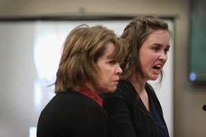 With her mother by her side, Helena Weick delivers a victim impact statement at the sentencing hearing for Larry Nassar, who has been accused of molesting more than 100 girls while he was a physician for USA Gymnastics and Michigan State University, on Jan. 17, 2018, in Lansing, Michigan. (Credit: Scott Olson / Getty Images)