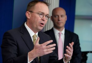 Office of Management and Budget Director Mick Mulvaney, left, speaks as Legislative Affairs Director Marc Short looks on during a press briefing in the White House on Jan. 20, 2018. (Credit: Mandel Ngan / AFP / Getty Images)